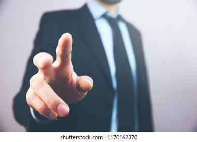 Businessman pressing button on virtual screen