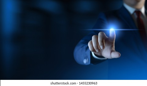 Businessman pressing button on virtual screen. Man pointing on futuristic interface. Space for text