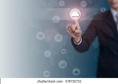 Businessman pressing button on virtual screen. cloud technology and networking concept.