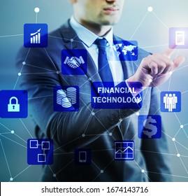 Businessman pressing buttons in fintech concept