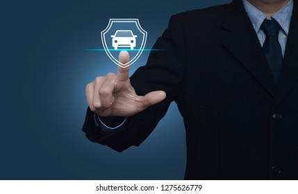 Businessman pressing car with shield flat icon over gradient light blue background, Business automobile insurance concept
