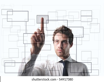 Businessman pressing the cell of a digital graphic