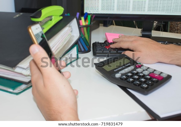 Businessman pressing computer button - financial analyzing concept. Finance, Business and accounting business