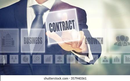 Businessman pressing an Contract concept button.