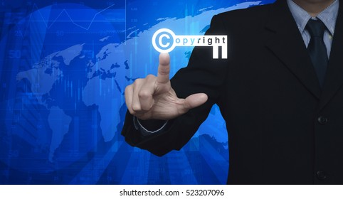 Businessman pressing copyright key icon over map and city tower, Copyright and patents concept, Elements of this image furnished by NASA