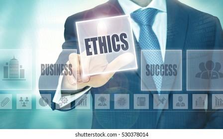 Businessman pressing an Ethics concept button.