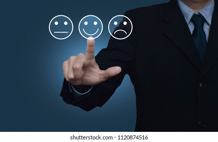 Businessman pressing excellent smiley face rating icon over gradient light blue background, Business customer service evaluation and feedback rating concept