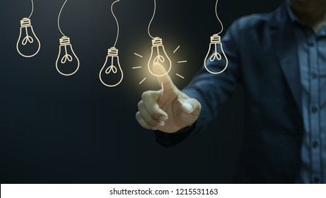 Businessman pressing light creative  idea .Concept  idea and innovation