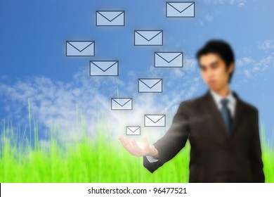Businessman pressing messaging type of modern icons