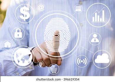 Empresario presionando panel de tecnología moderna con huella digital