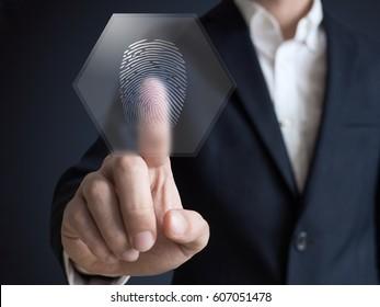 Businessman pressing modern technology panel finger print