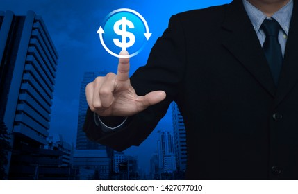 Businessman pressing money transfer flat icon over modern office city tower and skyscraper, Business currency exchange service concept
