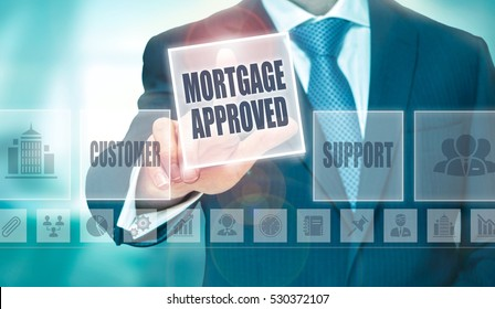A businessman pressing a Mortgage Approved button on a transparent screen.
