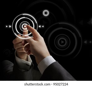 Businessman pressing multimedia type