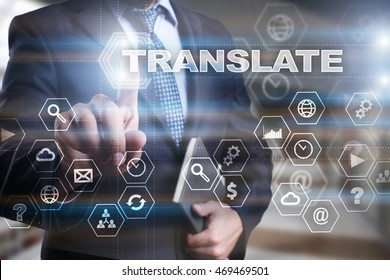 """Businessman is pressing on the virtual screen and selecting """"Translate""""."""