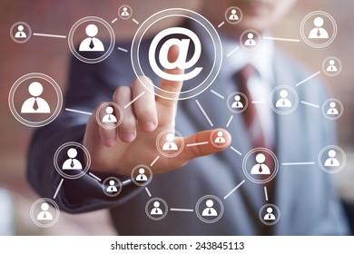 Businessman pressing online messaging mail icon sending