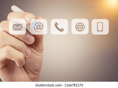 Businessman pressing phone button