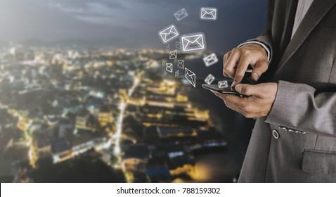 businessman pressing phone,send messagecompany identification / concept contact us