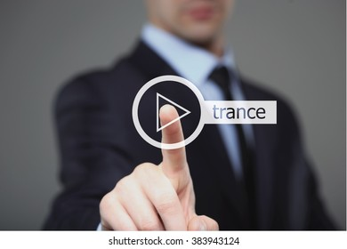 Businessman pressing play trance music button