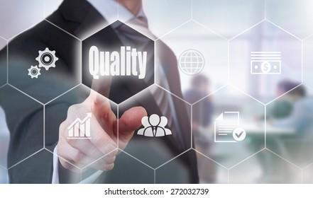 Businessman pressing a Quality concept button.