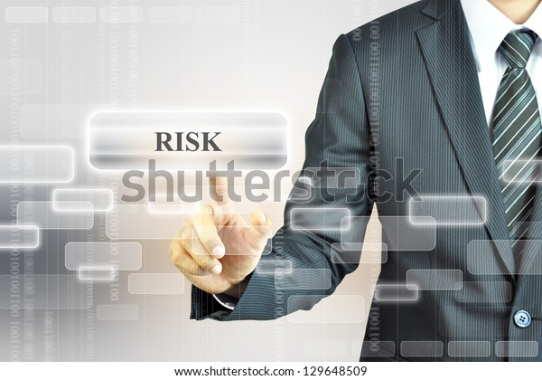 Businessman pressing RISK sign virtual screen - business abstract