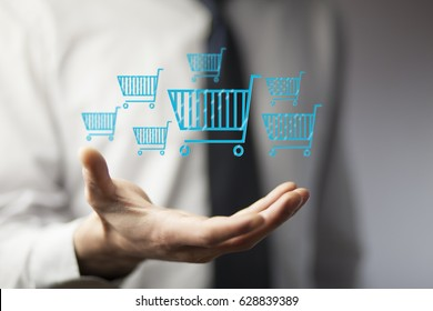 Businessman pressing shopping basket icon over blue background