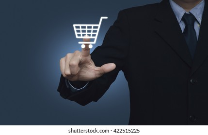 Businessman pressing shopping cart icon over blue background, Shopping online concept