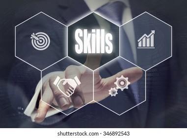 Businessman pressing an Skills concept button.