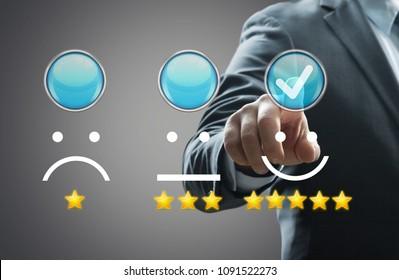 Businessman pressing smiley face emoticon