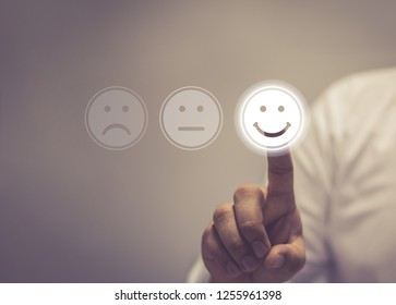 Businessman pressing smiley face touch screen . Business Service Satisfaction concept