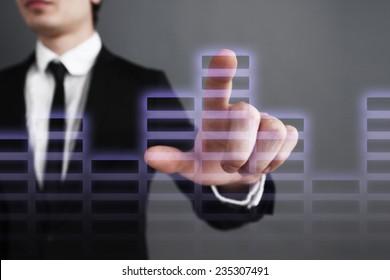 Businessman pressing touch screen interfa. bar chart analysis. financial growth