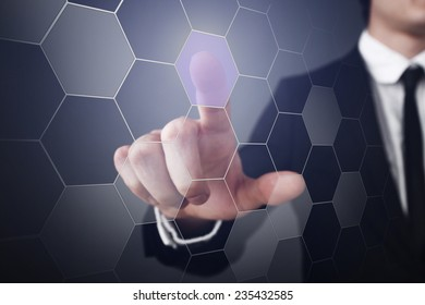 Businessman pressing touch screen interface
