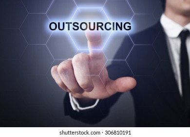 """Businessman pressing touch screen interface and select icon """"outsourcing"""". Business concept. Internet concept."""
