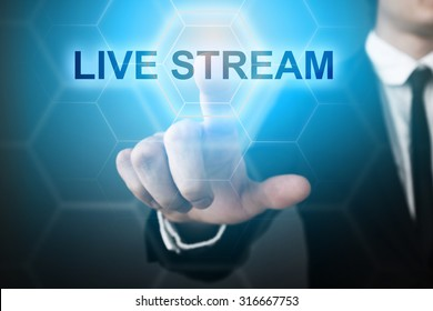 """Businessman pressing touch screen interface and select """"live stream""""."""