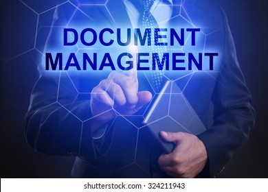 """Businessman pressing touch screen interface and select """"Document management""""."""