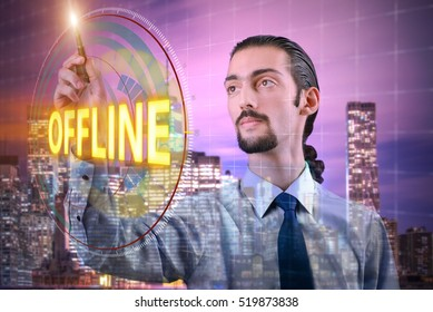 Businessman pressing virtual button offline