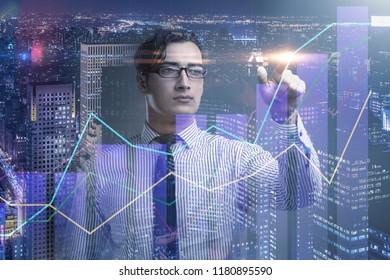 BUsinessman pressing virtual button on diagram chart