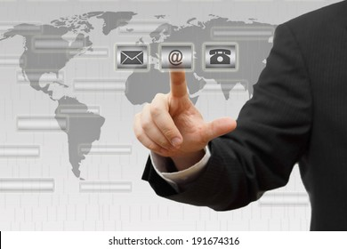 Businessman pressing virtual ( mail,phone,email ) buttons. Contact us concept