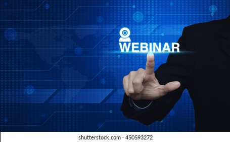 Businessman pressing webinar button over digital world map blue background, Seminar online concept, Elements of this image furnished by NASA