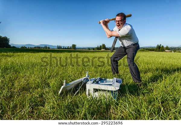 A businessman or IT professional beats on a laser printer