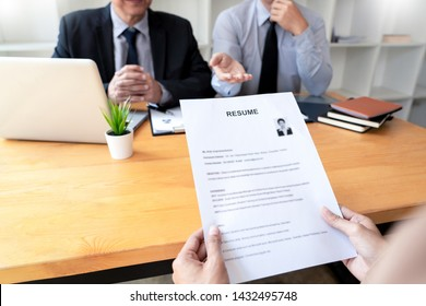 businessman professional women in suit explaining about her profile to business managers holding reading a resume, interview the job hiring career and placement concept.