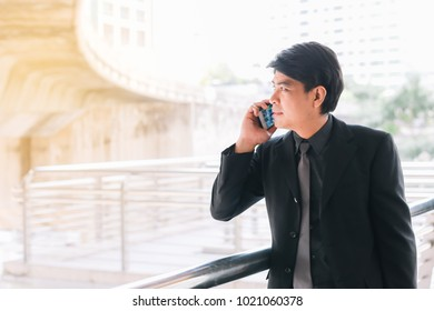 Businessman professionals are using mobile phone to communicate to add more channel sinternational clients and increase conversations with customers.
