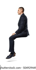 A businessman in profile in sitting position isolated on the white background. Business and management. Poses and gestures.
