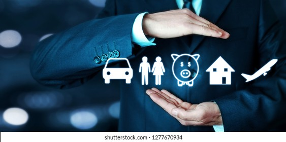 Businessman protecting car, family, piggy bank, house and airplane icons. Insurance