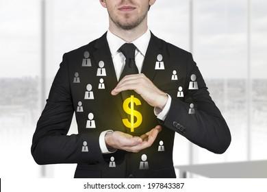 businessman protecting golden dollar symbol employees