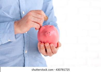 Businessman protecting his savings