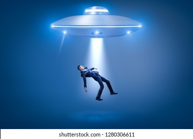 A businessman pulled toward an open hatch of a UFO by some invisible force. Close encounters. Extraterrestrial life. Alien visitors.