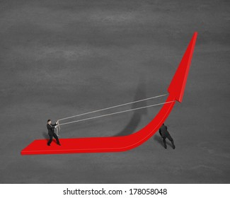 Businessman pulling up growing red arrow another pushing