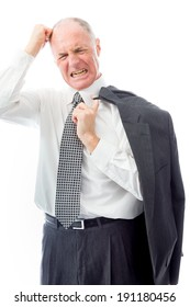 Businessman pulling his hair and screaming in frustration