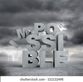 businessman pulling letters impossible concept on bad weather background